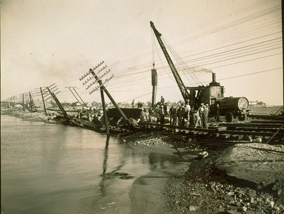 Pile driving machine at work on bridge at Lords Point in Mystic, Connecticut, after Hurricane of 1938