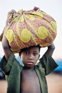 A young boy at the bus station in Sikasso, Mali