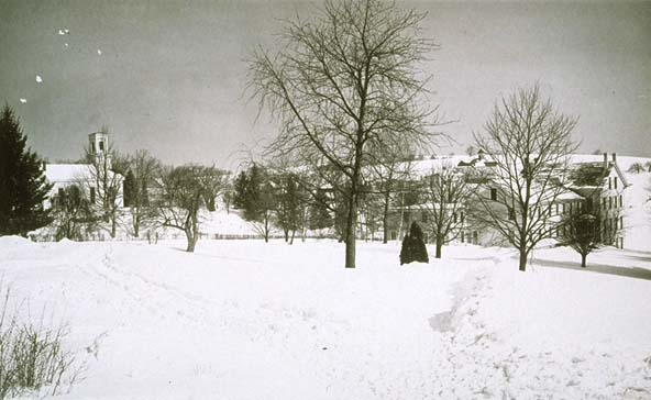 Campus in winter [looking east at Storrs Congregational Church and Old Whitney Hall], undated