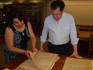 Curator, Marisol Ramos showing Strochlitz Travel Grant awardee Forest Hylton a Bolivian newspaper