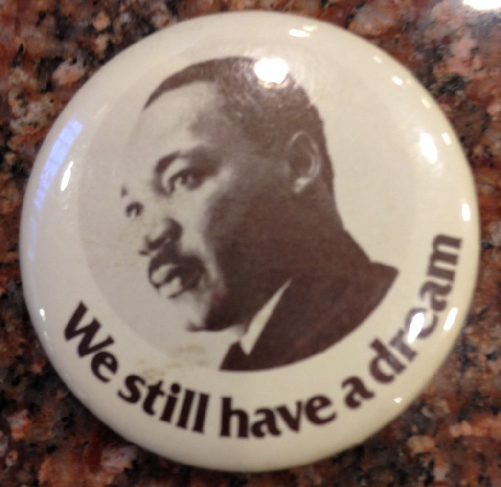 Political button depicting Dr. Martin Luther King, Jr.