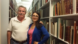 Luis Géigel and his daughter, Bianca Géigel Lonergan in the stacks where part of the Puerto Rican collection is located (06/18/2014).