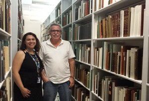 Marisol Ramos, Curator, with Luis Géigel at the stacks