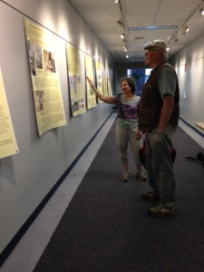UConn Professor Ruth Glasser shows her exhibit Brass City/Grass Roots to UConn Libraries staff member Bill Miller, June 2015