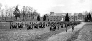 ROTC Cadets standby for inspection of their encampments and equipment, 1919. Hawley Armory is in the background. Laurel Hall now stands on the site of the parade field