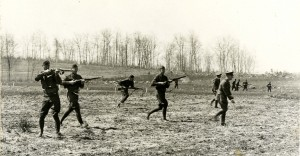 "Cadets conducting a ""mock battle"" on campus, WWI era."