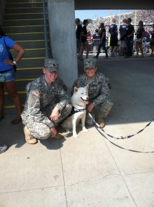 Cadet Lieutenants Nick Hurley (hmm..the name sounds familiar!) and Ashley Cuprak, both CLAS '13, pose with Jonathan the Husky during a UConn football game at Rentschler Field in 2011.