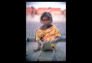 Bonded (slave) Child Laborer At A Brick Kiln