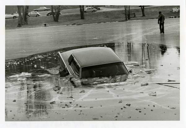 Car submerged in frozen Duck Pond, 1972