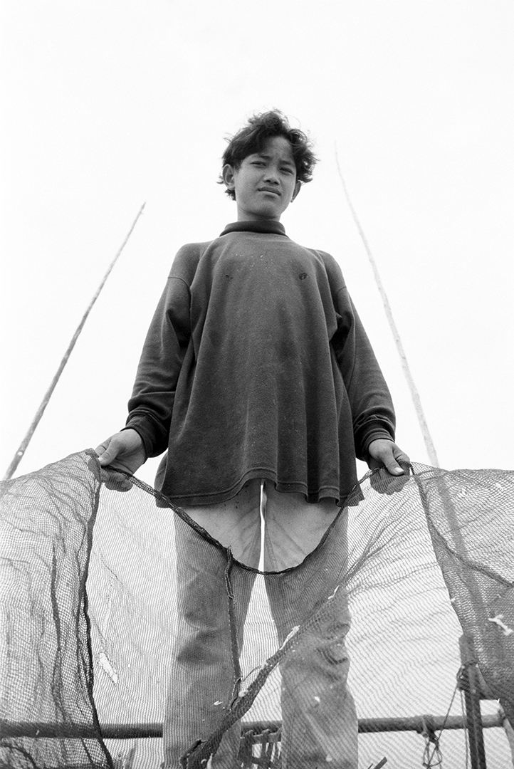 Young Boy Holds Fishing Net on Jermal