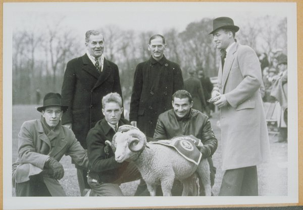 Rhode Island State College mascot Rameses II with RISC President Bressler and Connecticut State College President Charles McCracken, with students