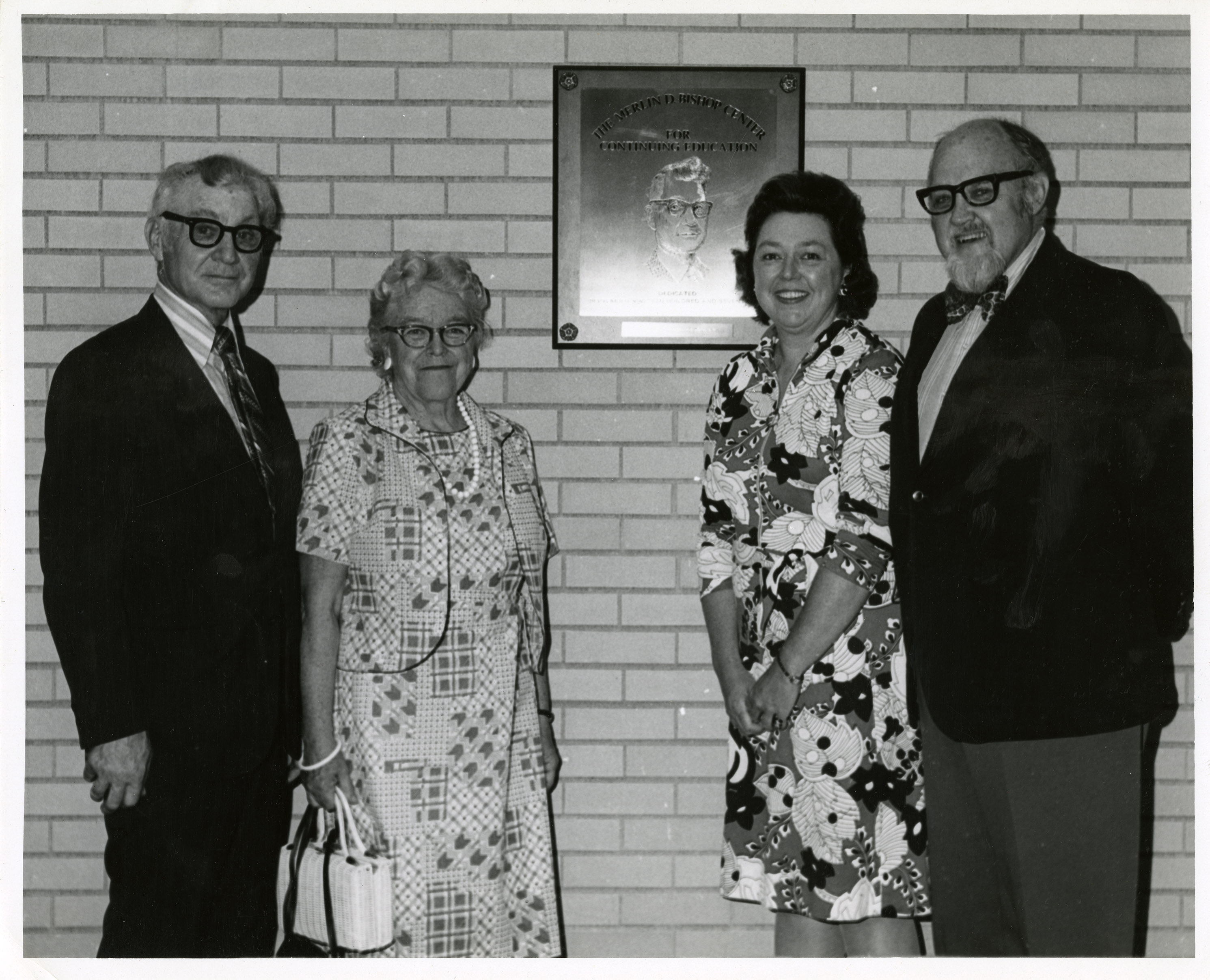 Merlin D. Bishop, his wife Dorothy and two unidentified people in the Bishop Center, undated