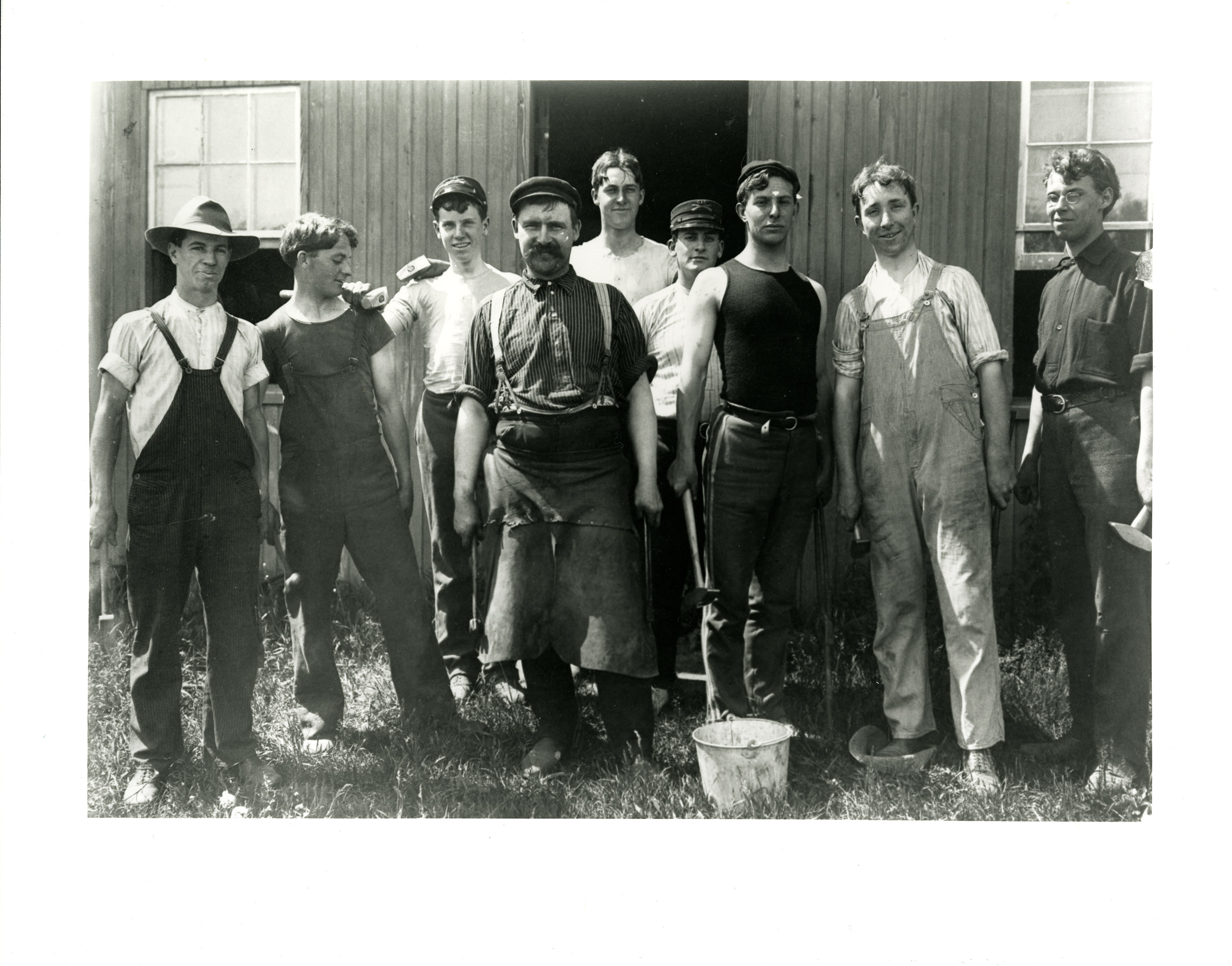 Connecticut Agricultural College students at a blacksmithing class, 1905