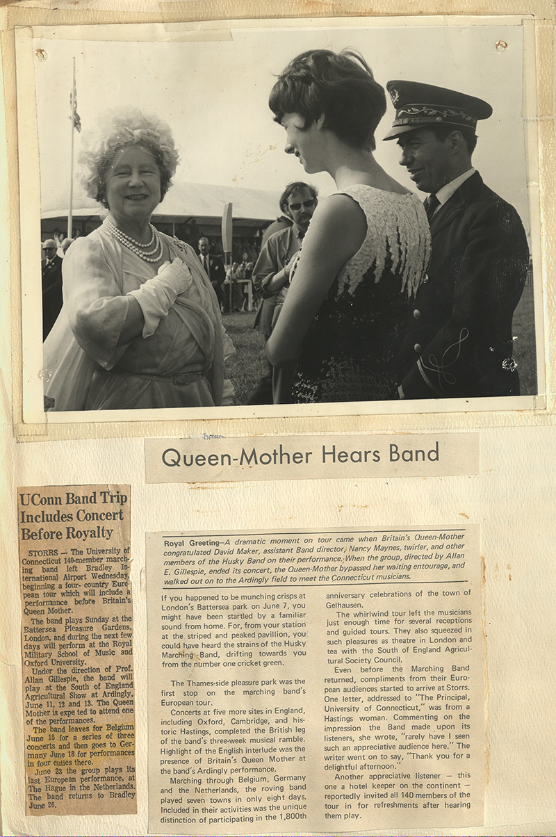UConn Marching Band 1970 European Tour scrapbook page, including a photo of David Maker (Assistant Director) and Nancy Maynes (twirler) of the band meeting the Queen-Mother of England