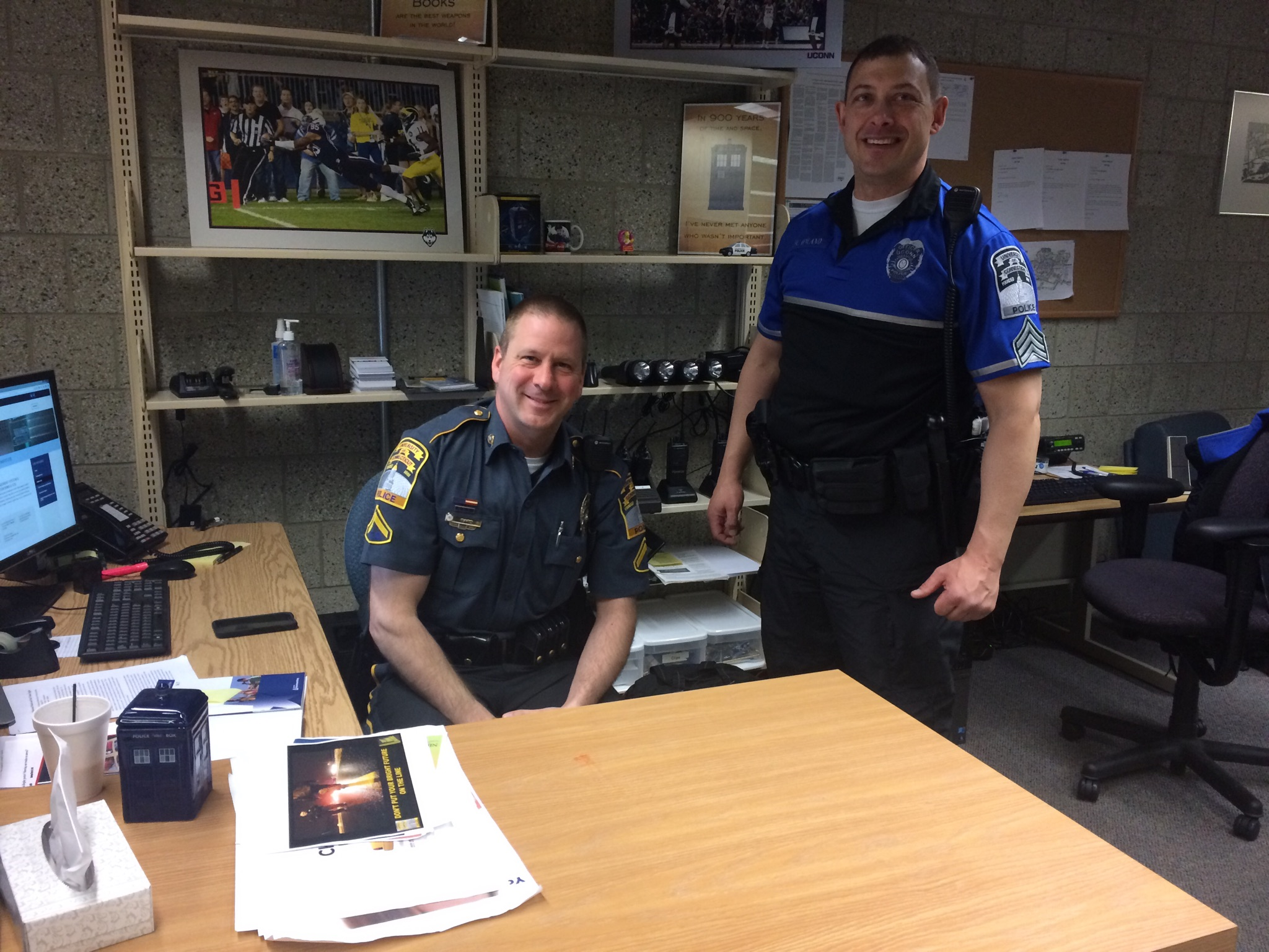 Officer Eric Bard (left) and Sergeant Jason Hyland man the Babbidge Library Substation, which aims to improve communication between students and the police.