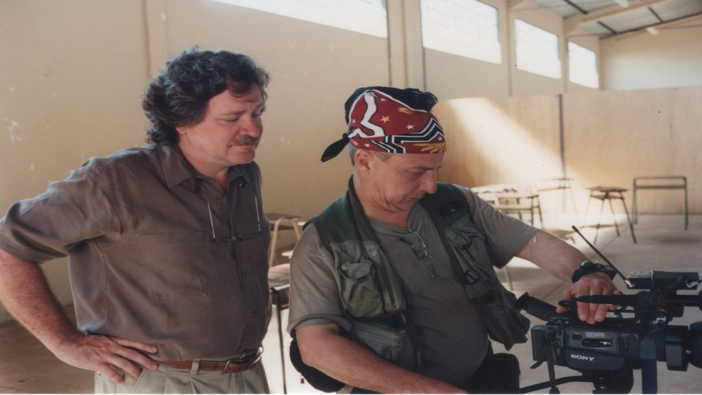 Len Morris, left, and Robin Romano filming at a school in Brazil.