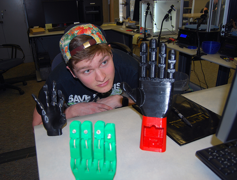 Student Stephen Hawes with his prosthetic hands